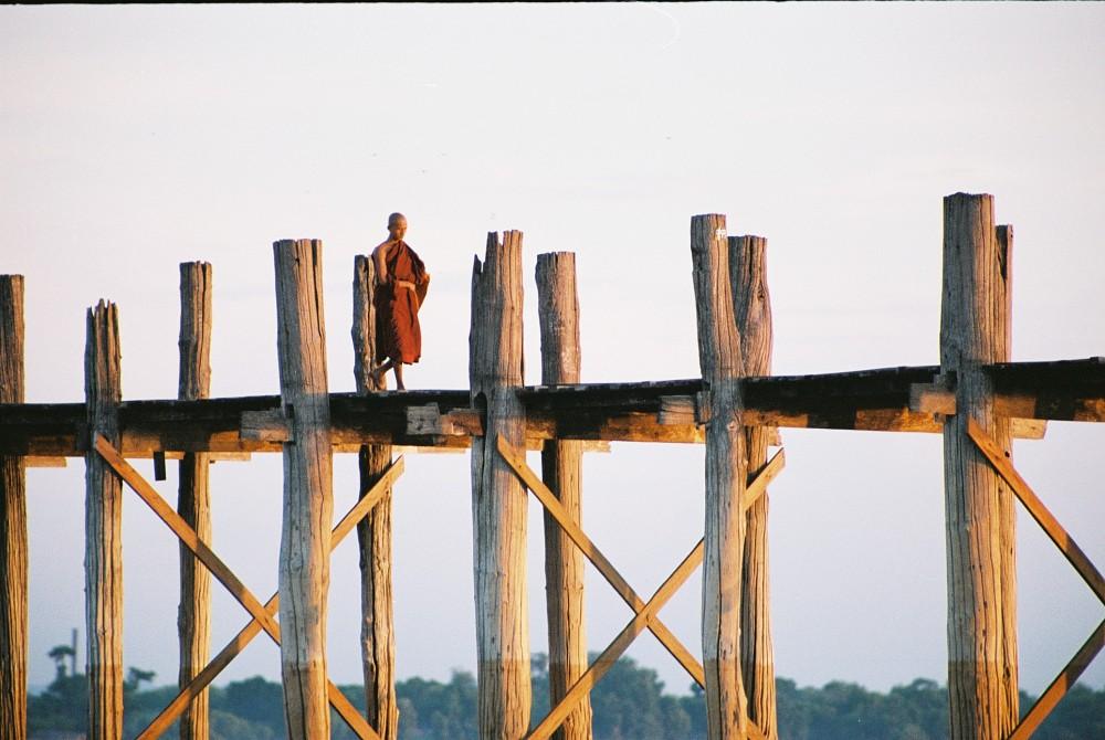 Monk on the 200-year-old U Bein's Bridge in Myanmar (aka Burma) © Caroline Sylger Jones